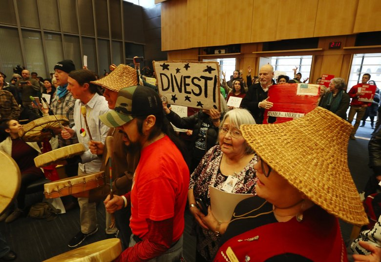 A Native American Leadership drumming ceremony starts the full Seattle City Council hearing Tuesday. (Ken Lambert / The Seattle Times)