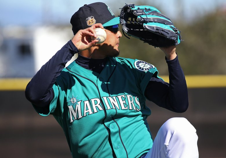 Seattle Mariners pitcher Hisashi Iwakuma works out during the second day of spring training. (Ken Lambert / The Seattle Times)