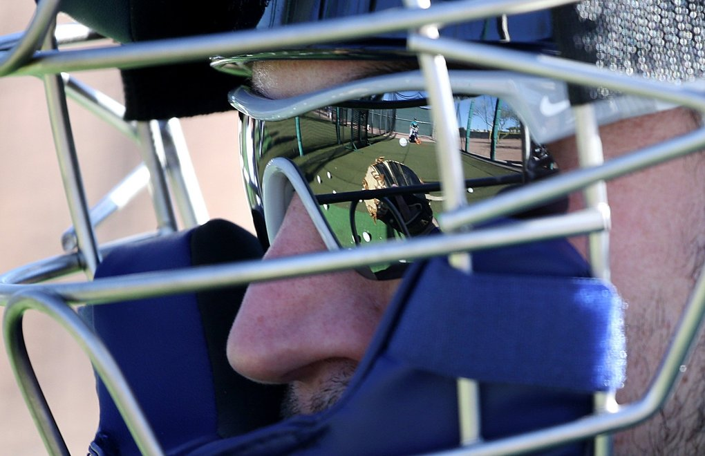 A reflection in his sunglasses gives Mike Zunino's view of a ball coming in fast from a pitching machine, during the second day of spring training for the Seattle Mariners, Wednesday, Feb. 15, 2017, in Peoria, Ariz. 200768 (Ken Lambert / The Seattle Times)