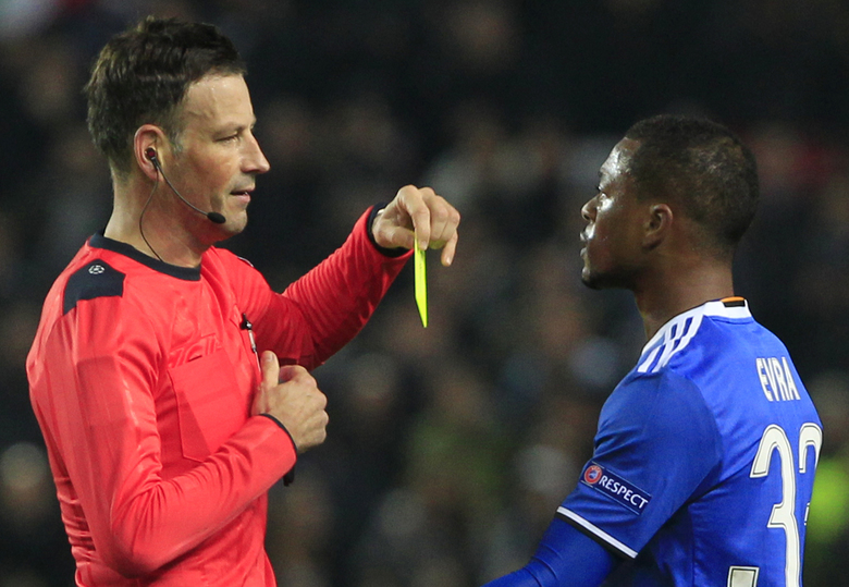FILE – This is a Tuesday Nov. 22, 2016 file photo of English referee Mark Clattenburg of Britain as he shows a yellow card to Juventus' Patrice Evra during the Group H Champions League soccer match between Sevilla and Juventus at the Ramon Sanchez-Pizjuan stadium in Seville, Spain. Clattenburg, who refereed the top games in world soccer in 2016, is quitting the Premier League for a job in Saudi Arabia. The English refereeing organization announced Thursday Feb. 16, 2017 that  Clattenburg's departure in a statement which didn't specify the role he will take in the Middle East nation. (AP Photo/Miguel Morenatti, File)
