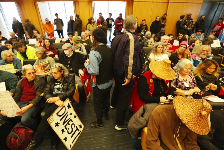 The City Council chamber is packed. (Ken Lambert/The Seattle Times)