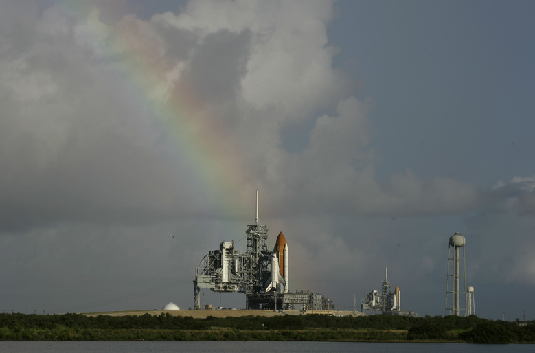 FILE – In this Saturday, Sept. 20, 2008 file photo, space shuttle Atlantis on pad 39A, left, and Endeavour on pad 39B stand ready in front of a rainbow in the early morning at Kennedy Space Center in Cape Canaveral, Fla. Dormant for nearly six years, Launch Complex 39A at NASA's Kennedy Space Center should see its first commercial flight on Feb. 18, 2017. A SpaceX Falcon 9 rocket will use the pad to hoist supplies for the International Space Station. (AP Photo/John Raoux)