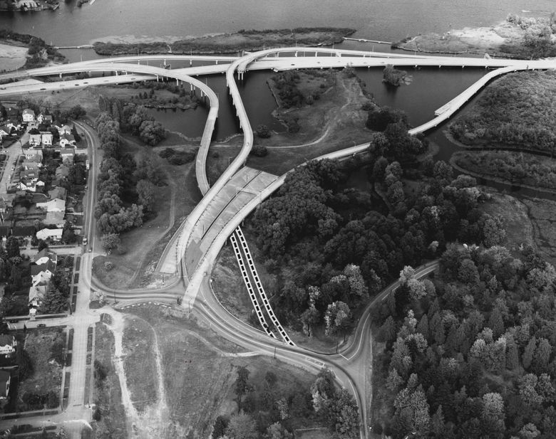 A photo shows bridge ramps left uncompleted when Seattle abandoned the R.H. Thomson Expressway project. Broken lines show how one ramp might have been made usable.  (Bruce McKim/The Seattle Times)