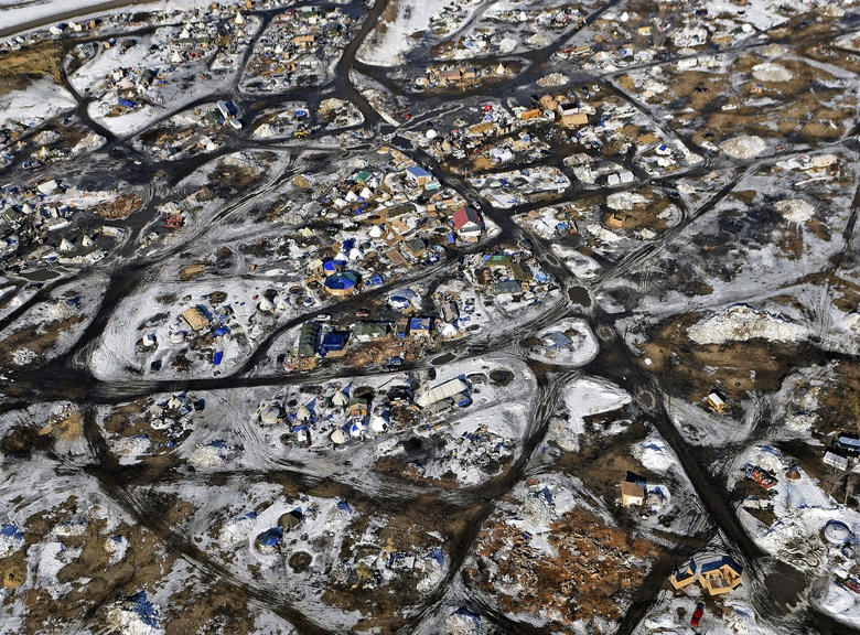 This aerial photo shows the Oceti Sakowin camp, where people have gathered to protest construction of the Dakota Access pipeline in Cannon Ball, N.D. A federal judge on Monday refused to stop construction on the last stretch of the Dakota Access pipeline, which is progressing much faster than expected. (Tom Stromme/The Bismarck Tribune via AP)  (Tom Stromme/AP)