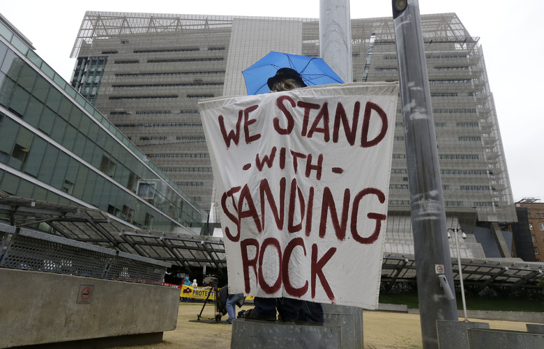 Opponents of the Dakota Access oilpipeline protest at the San Francisco Federal Building in San Francisco, Wednesday, Feb. 8, 2017. Opponents of the Dakota Access oilpipeline called for protests around the world Wednesday as the Army prepared to green-light the final stage of the $3.8 billion project's construction. (AP Photo/Jeff Chiu)