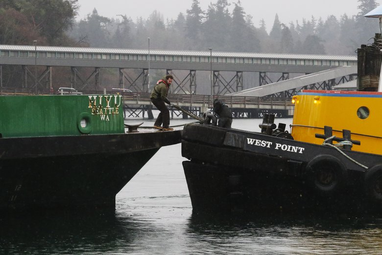 The tug West Point ties up to the stern of the former Washington State ferry Hiyu to move it from Eagle Harbor on Bainbridge Island to South Lake Union.  (Alan Berner/The Seattle Times)