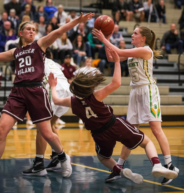 Mercer Island's Anna Luce (20) and Claire Mansfield throw themselves as defending the pass into the lane by Blanchet's Ella DiPietro in the first half.  (Dean Rutz/The Seattle Times)