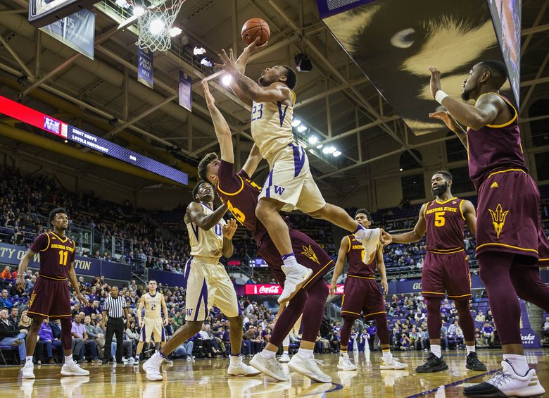 Washington's Carlos Johnson gets position on Arizona State's Ramon Vila for a shot in the first half.  (Dean Rutz/The Seattle Times)