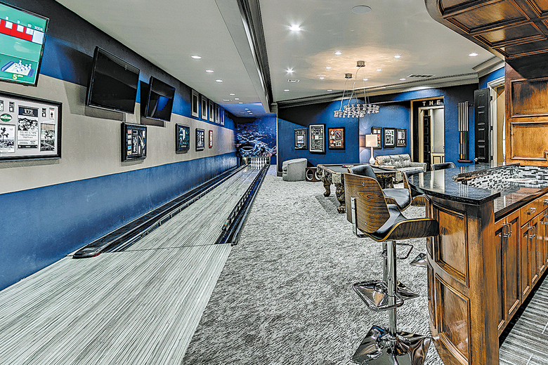 A private bowling lane is an extreme example of the way homeowners are personalizing the modern rec room.