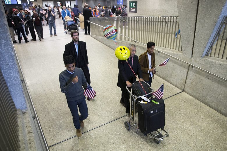 A Yemeni family is reunited at Washington Dulles International Airport Monday (European Pressphoto Agency).