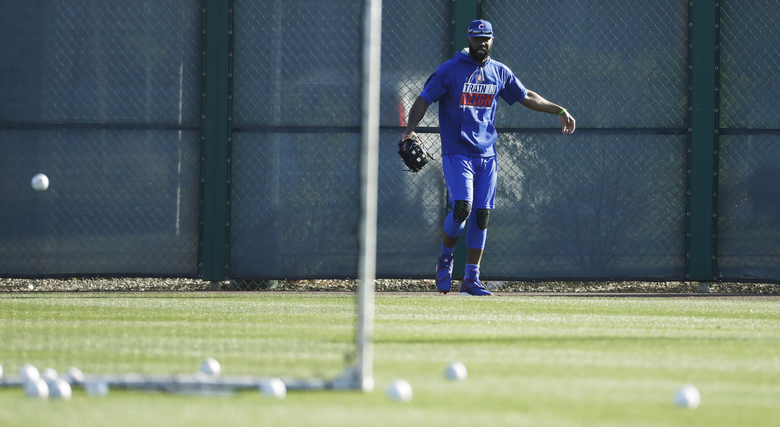 Chicago Cubs' Jason Heyward catches balls in the outfield during a spring training baseball workout Tuesday, Feb. 14, 2017, in Mesa, Ariz. (AP Photo/Morry Gash)