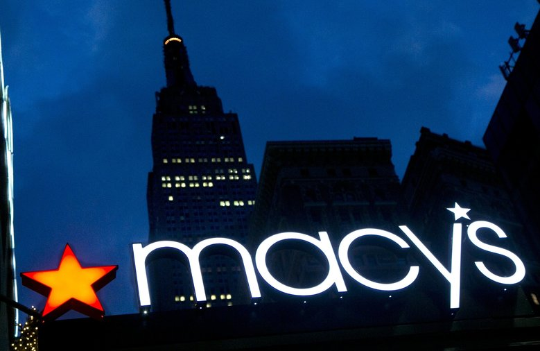 FILE – In this Nov. 21, 2013, file photo, with the Empire State building in the background, the Macy's logo is illuminated on the front of the department store in New York. A new year season is biting back at Macyâ??s and Kohlâ??s early in the new year, with the duoâ??s shares tumbling in premarket trading on Thursday, Jan. 5, 2017, following news that they had trouble bringing shoppers into their stores to buy presents. (AP Photo/Mark Lennihan, File) NY109