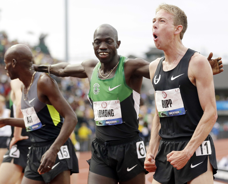 """FILE – In this June 28, 2012, file photo, Galen Rupp, right, Bernard Lagat, left and Lopez Lomong celebrate after finishing the men's 5,000 meter finals at the U.S. Olympic Track and Field Trials in Eugene, Ore. The American middle-distance runner's new home is creating fresh fear that's weighing on him with President Donald Trump's order to temporarily suspend all immigration for citizens of seven majority-Muslim countries. Lomong, one of the """"Lost Boys"""" of Sudan, has two brothers from South Sudan running at American colleges. He worries for them. For his mom and sister back in Africa, too. (AP Photo/Marcio Jose Sanchez, File)"""