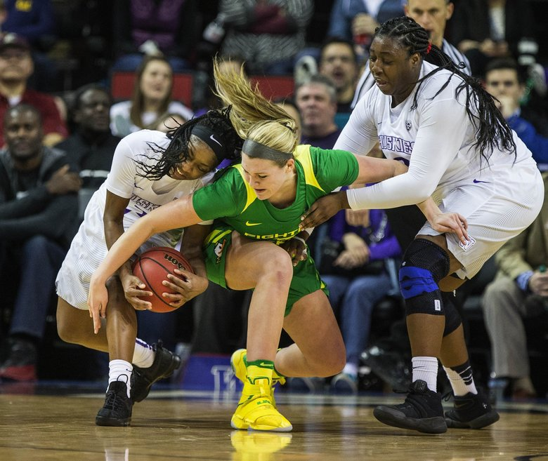 Washington's Aarion McDonald comes up with a big turnover of Oregon's Mallory McGwire in the 2nd half.  (Dean Rutz / The Seattle Times)