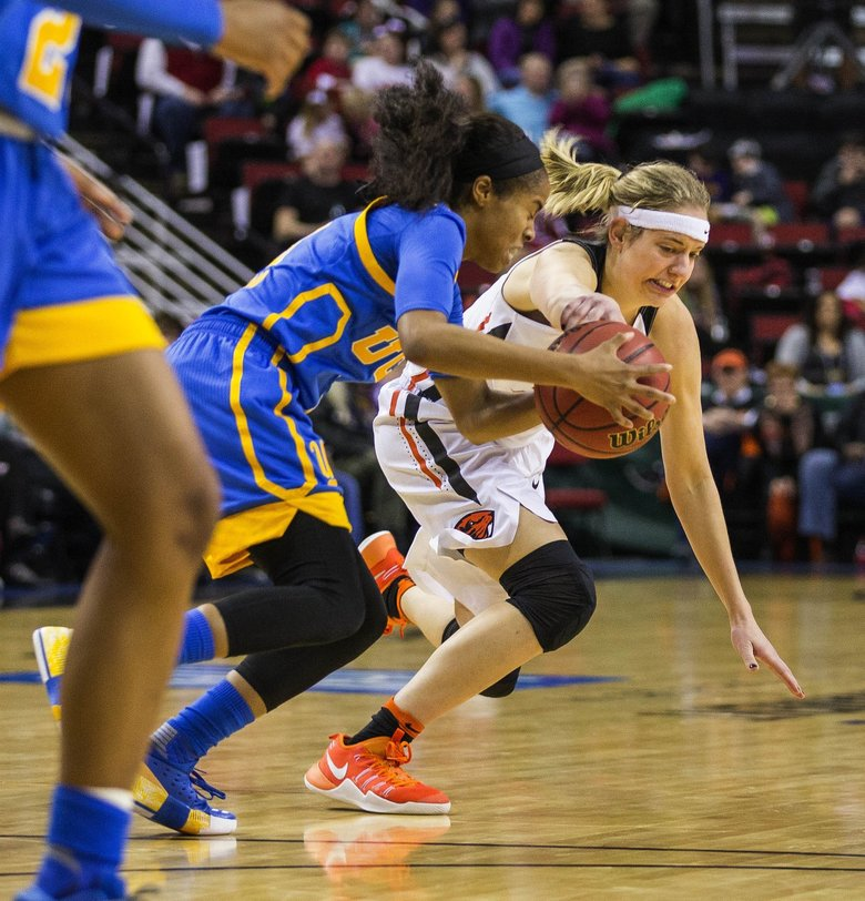 UCLA's Jordin Canada turns over Oregon State's Sydney Wiese in the 2nd half.  T(Dean Rutz / The Seattle Times)