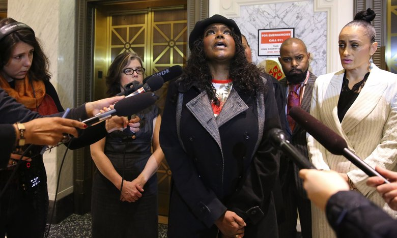 Che Taylor's widow Brenda Taylor protests King County prosecutor Daniel Satterberg's decision on Tuesday to not to file charges against Seattle police officers in the fatal shooting. (Ken Lambert / The Seattle Times)