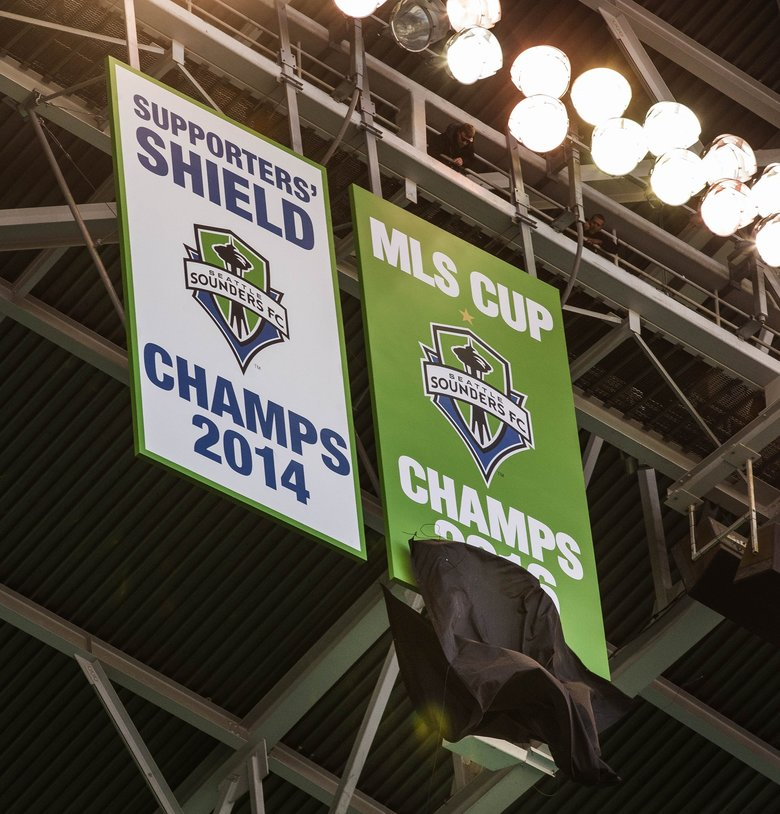 The Sounders drop the banner commemorating their 2016 MLS Cup Championship. (Dean Rutz / The Seattle Times)