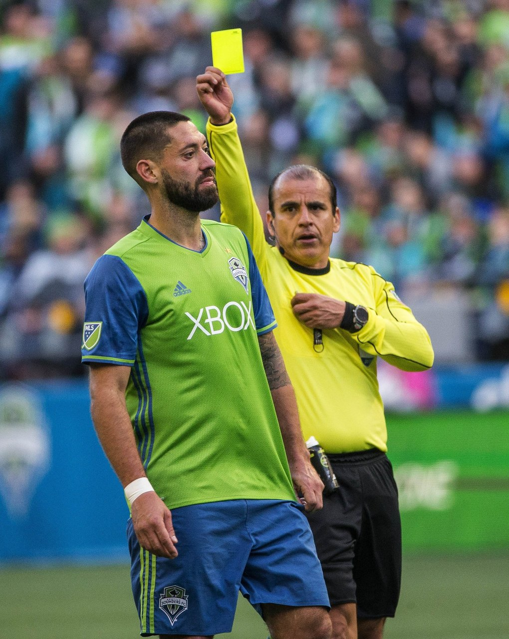 Clint Dempsey is shown the yellow card for a bad foul by referee Baldomero Toledo. (Dean Rutz / The Seattle Times)