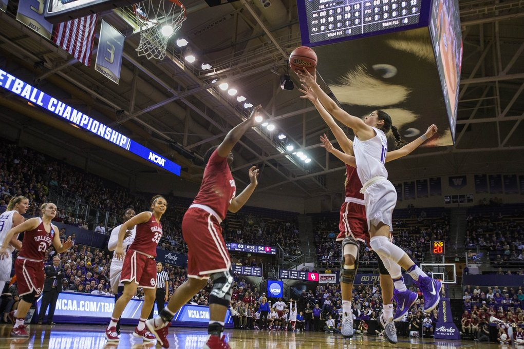 Kelsey Plum breaks the single-season scoring record among NCAA women with this bucket in 3rd quarter against Oklahoma.   (Dean Rutz / The Seattle Times)