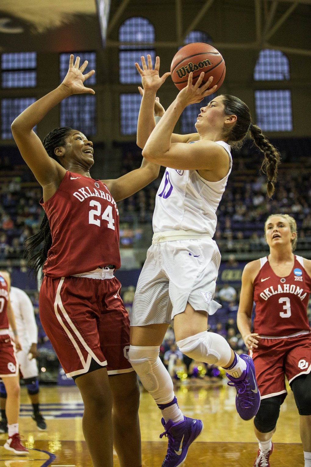 Kelsey Plum goes up against against Oklahoma's Ijeoma Odimgbe in the 1st half.   (Dean Rutz / The Seattle Times)