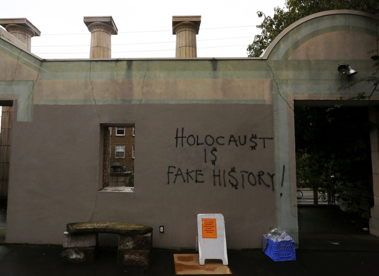Anti-Semitic graffiti was spray-painted on the facade of the sanctuary at Seattle's Temple De Hirsch Sinai March 9.  (Alan Berner/The Seattle Times)