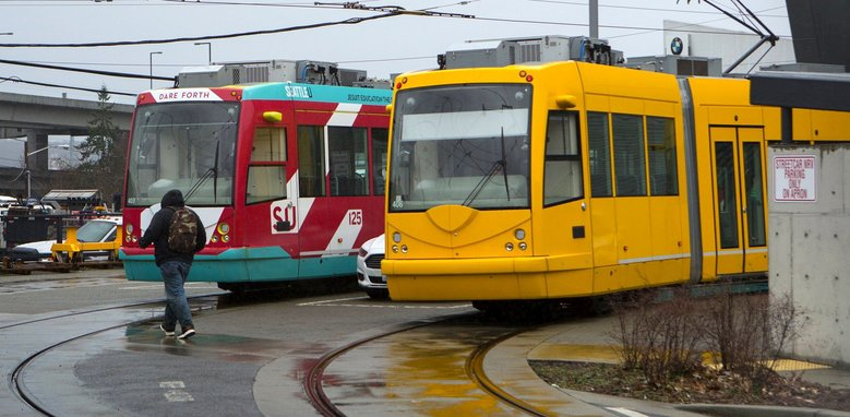 First Hill streetcars sit idle March 3 in the yard at Eighth Avenue South and South Dearborn Street in Seattle. (Ellen M. Banner/The Seattle Times)