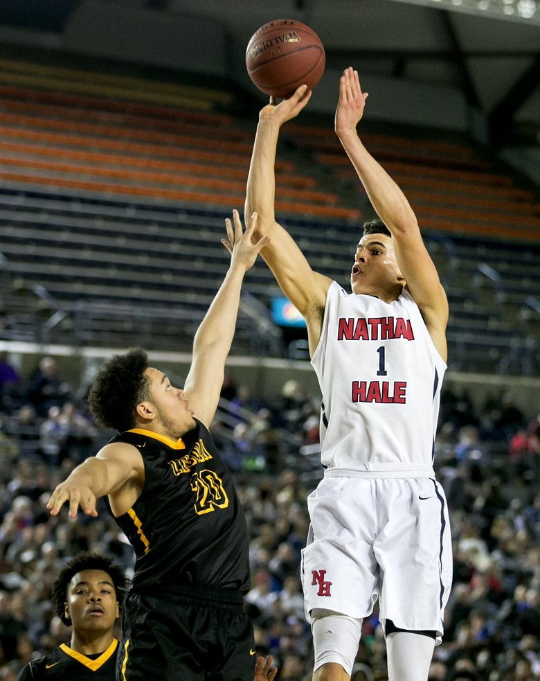 Michael Porter Jr. of Nathan Hale shoots over Jakhai Dillingham of Lincoln. Porter scored 27 points and pulled down 13 rebounds to help Nathan Hale win 84-60.  (Johnny Andrews/The Seattle Times)