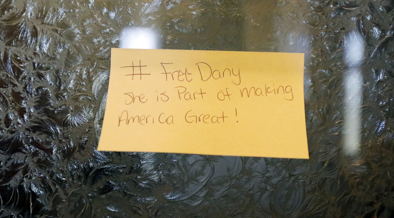 """A sticky note, calls for freeing 22-year old Daniela Vargas, a Argentine native who has lived in the United States since she was seven years old, was placed on a lawmaker's office door at the Capitol in Jackson, Miss., Friday, March 3, 2017, Vargas was detained, March 1, by immigration agents who state that she is a """"unlawfully present Argentinian citizen"""" during a """"targeted immigration enforcement action."""" (AP Photo/Rogelio V. Solis)"""