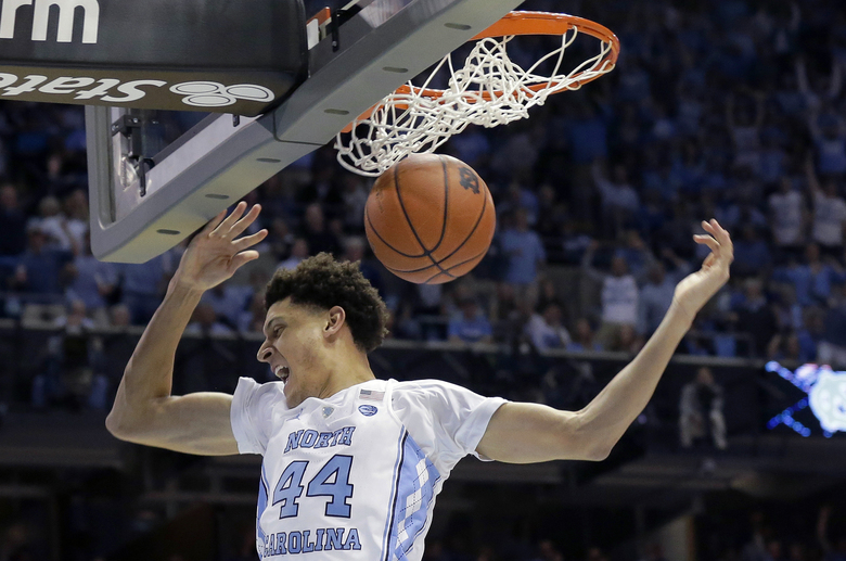 FILE – In this March 4, 2017, file photo, North Carolina's Justin Jackson (44) dunks against Duke during the first half of an NCAA college basketball game in Chapel Hill, N.C. Jackson was selected to The Associated Press NCAA college basketball men's All-America first team, Tuesday, March 28, 2017.(AP Photo/Gerry Broome, File)