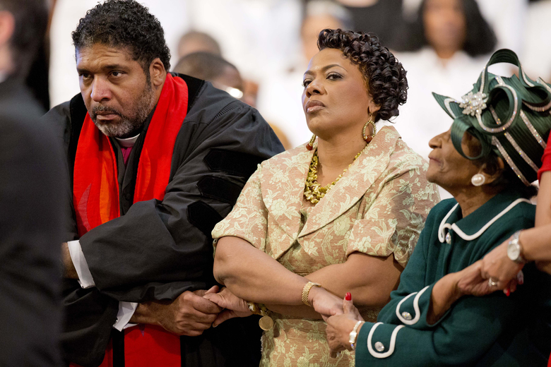 "FILE – In this Jan. 18, 2016, file photo, the Rev. Dr. William Barber II, left, holds hands with the Rev. Bernice King, center, and Christine King Farris, right, the daughter and sister of the Rev. Martin Luther King Jr., during the singing of ""We Shall Overcome"" at the Rev. Martin Luther King Jr. holiday commemorative service at Ebenezer Baptist Church in Atlanta. A cluster of Black Lives Matter groups and an organization leading the push for a $15-an-hour wage, Fight for $15, are joining forces for their first national joint action, planning ""Fight Racism, Raise Pay"" protests on the 49th anniversary of the Rev. Martin Luther King Jr.'s assassination, April 4, 2017, in two dozen cities, including a protest led by Barber in Memphis, Tenn. (AP Photo/David Goldman, File)"