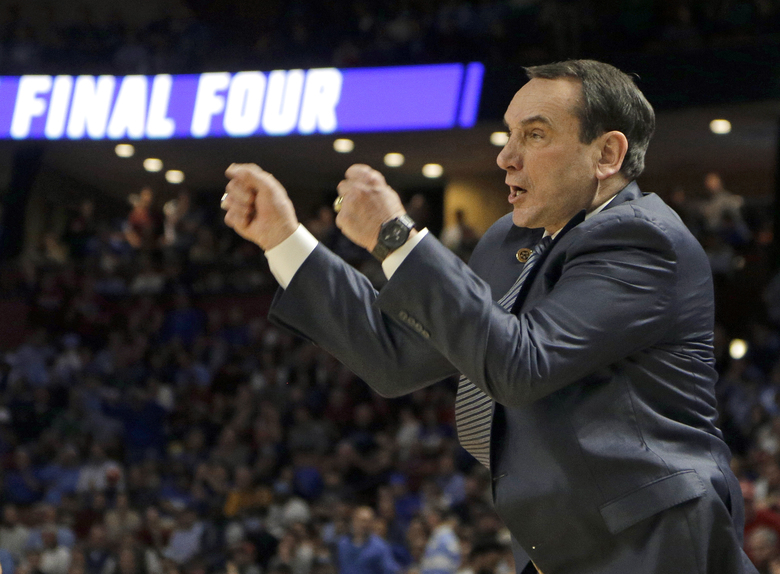 Duke head coach Mike Krzyzewski shouts at his team during the first half in a second-round game against South Carolina in the NCAA men's college basketball tournament in Greenville, S.C., Sunday, March 19, 2017. (AP Photo/Chuck Burton)