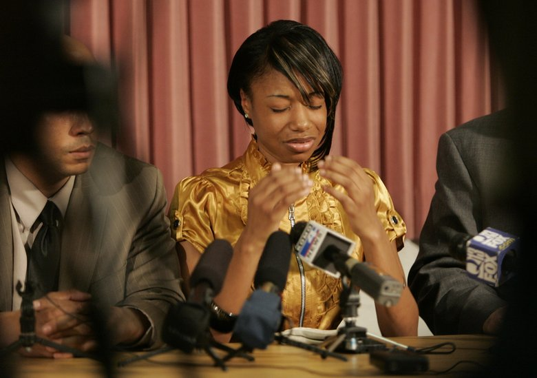 Aiesha Steward-Baker in 2010 recalls the details of the bus-tunnel beating with her attorney, James Bible, at her side.  (JIM BATES/The Seattle Times)