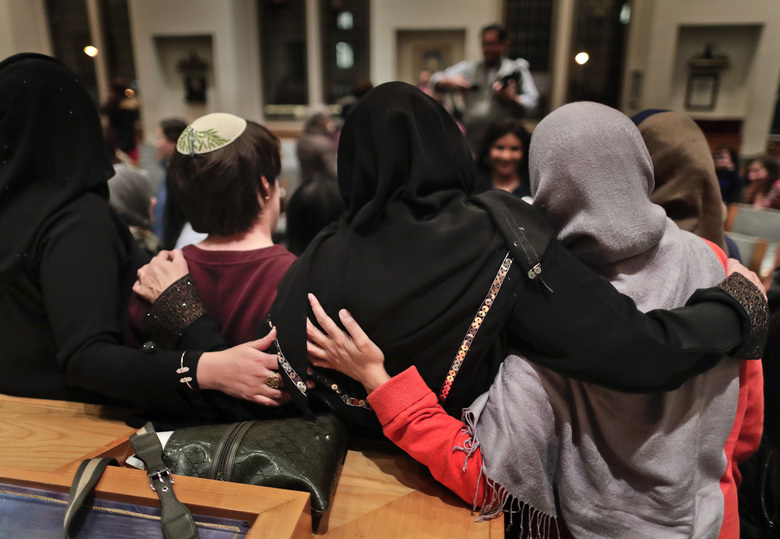 In this Thursday, Feb. 16, 2017 photo, members of the Sisterhood Salaam Shalom, gather for a group photo after a unity vigil held at the Jewish Theological Seminary in New York. The Sisterhood of Salaam Shalom, a national organization that brings together Muslim and Jewish women, organized the gathering as part of the organization's response to President Donald Trump's travel ban. (AP Photo/Julie Jacobson)
