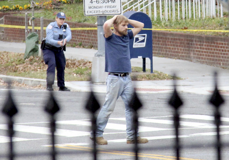 FILE – In this Sunday, Dec. 4, 2016 file photo, Edgar Maddison Welch, 28 of Salisbury, N.C., surrenders to police in Washington. Welch, who said he was investigating a conspiracy theory about Hillary Clinton running a child sex ring out of a pizza place, fired an assault rifle inside the restaurant on Sunday injuring no one, police and news reports said. Fake news, social media bots, a post-fact world. One of the great lessons of the 2016 U.S. presidential campaign is that people could not _ or would not _ distinguish between actual news stories and fabrications. (Sathi Soma via AP)