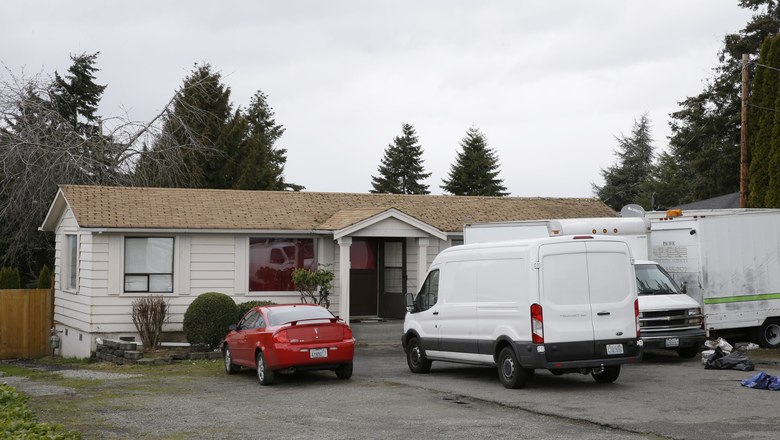 "Vehicles sit Sunday at the Kent home where a Sikh man was shot in the arm Friday. The man said he was working on a car in his driveway when the gunman told him to ""go back to your own country."" (Ted S. Warren/AP)"