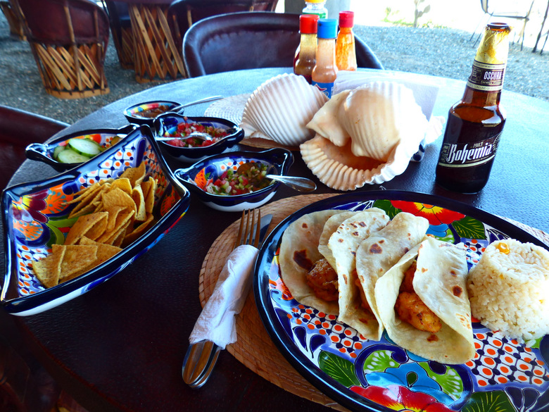After whale watching: shrimp tacos and a Mexican beer at Magdalena Whale Camp. (Brian J. Cantwell / The Seattle Times)