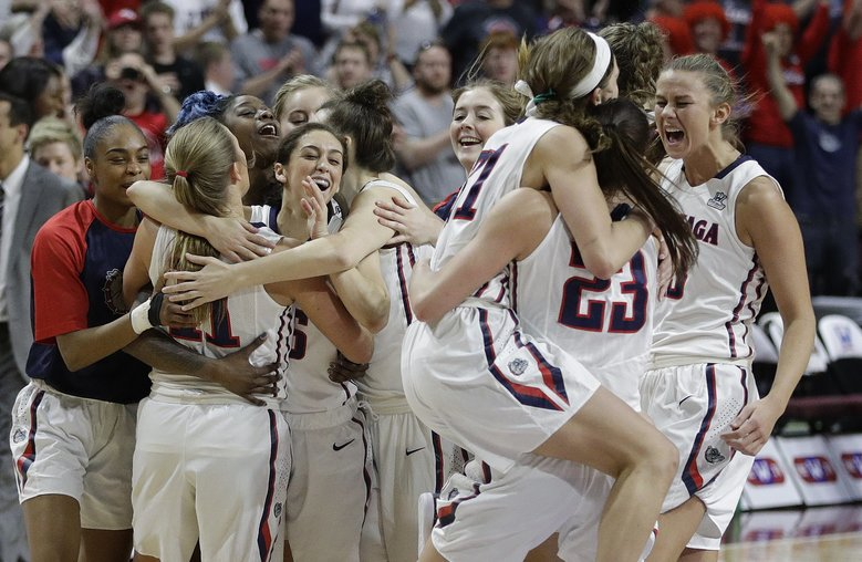 Gonzaga players celebrate after defeating Saint Mary's in the West Coast Conference tournament championship game Tuesday in Las Vegas. The Zags earned an automatic berth to the NCAA tournament. (John Locher/AP)
