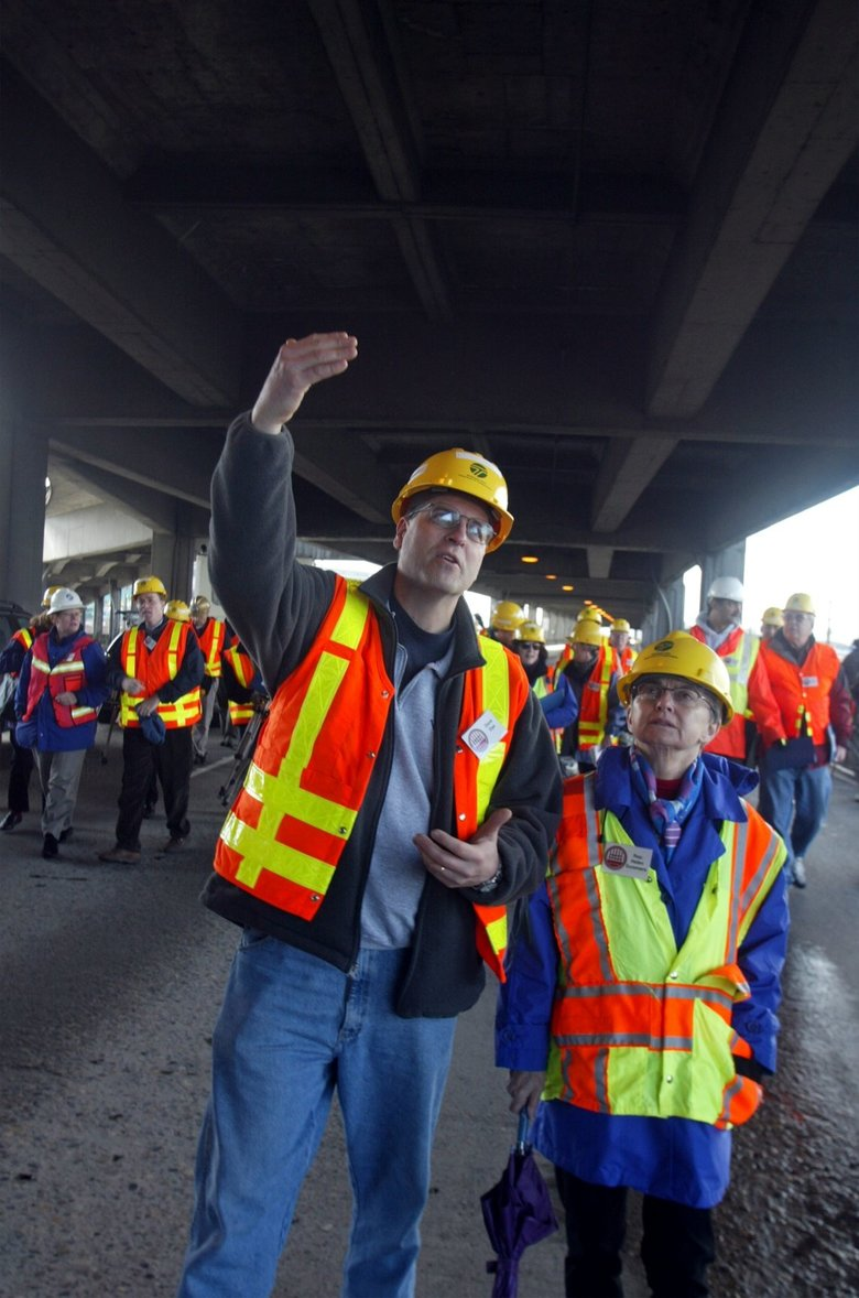 In 2003, State Department of Transportation employee Dave Dye walks along the lower section of the Alaskan Way Viaduct with state Rep. Helen Sommers, D-36th District. (Greg Gilbert/The Seattle Times)