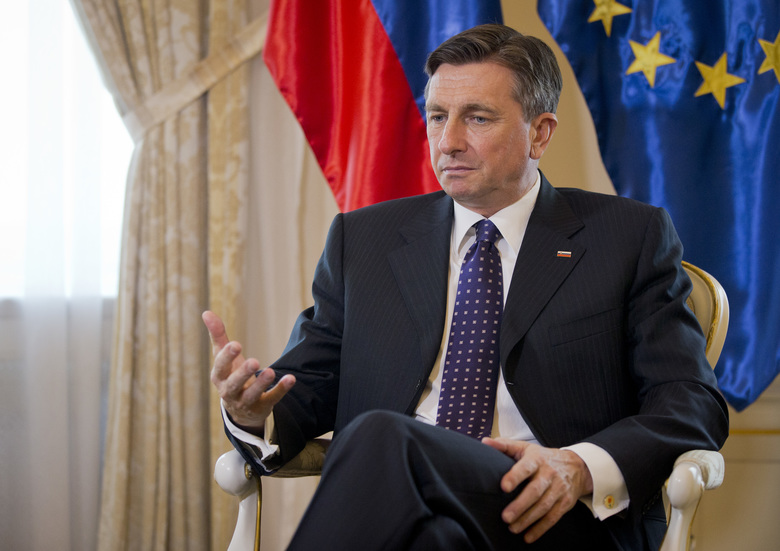 "Slovenia's president Borut Pahor gestures during an interview with the Associated Press in Ljubljana, Slovenia, Monday, March 6, 2017. Slovenia's president says his invitation for a summit between Donald Trump and Vladimir Putin stands. Borut Pahor told The Associated Press on Monday that a ""tradition"" of first meetings between U.S. and Russian presidents in the small Alpine state shouldn't be discarded — and Slovenia is also  the U.S. first lady's native land (AP Photo/Darko Bandic)"