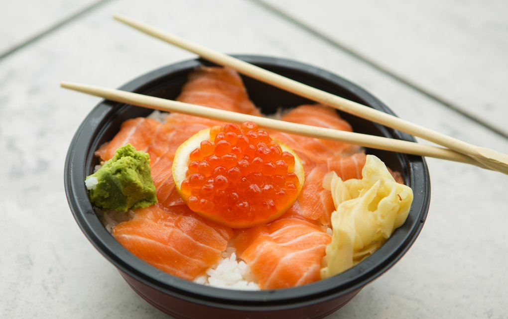 Salmon sashimi served over rice with lemon and roe, available at Leung Kee Cantonese Food, a restaurant in the food court at Aberdeen Centre shopping mall in Richmond, B.C. (Ellen M. Banner/The Seattle Times)