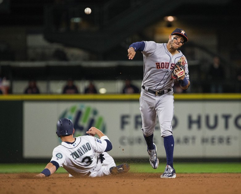 Houston's Carlos Correa gets Mike Zunino at 2nd, but can't turn the double play on Mike Freeman at 1st in the 6th.   (Dean Rutz / The Seattle Times)