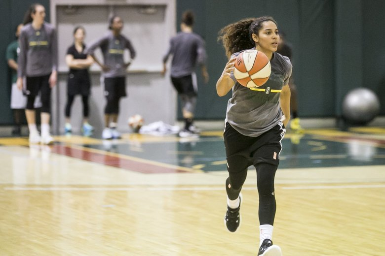 Jennifer O'Neill plays point guard on the first day of training camp . (Bettina Hansen / The Seattle Times)