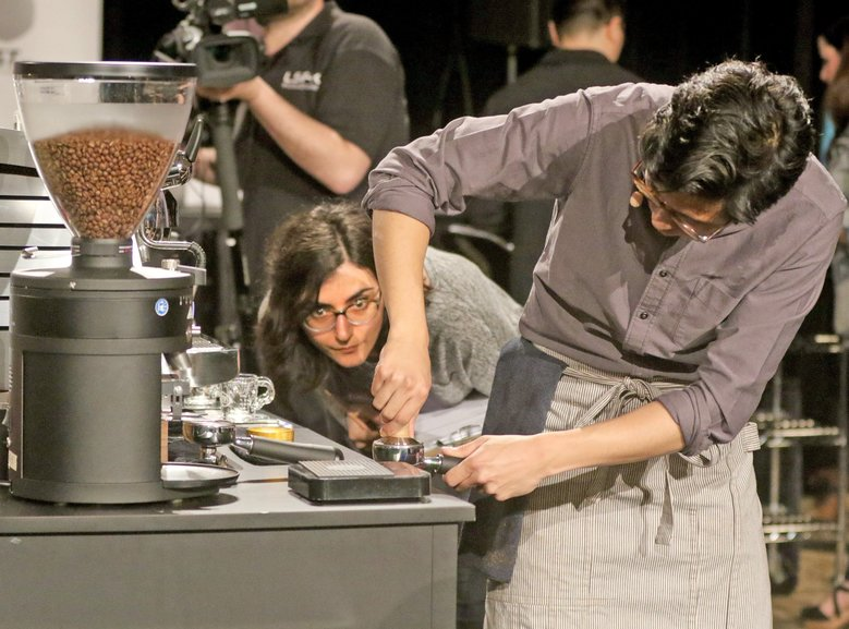 New York barista David Castillo, of Joe Coffee Co., brews up a beverage as judge Diana Mnatsakanyam-Sapp, with Undercurrent Coffee of Charlotte, N.C., observes his brewing technique. Castillo is competing in the US Barista Championship at the Convention Center in Seattle. The winner will be announced Sunday afternoon. There are a total of 36 competitors in the barista competition this year, including three from Seattle. (Greg Gilbert/The Seattle Times)