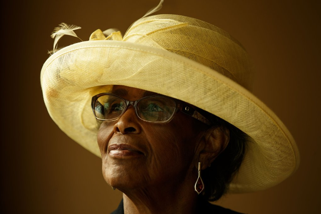 "Ruth Render in one of her Sunday hats. ""There's something about a hat,"" said the retired Boeing employee. ""It makes me look beautiful."" (Erika Schultz / The Seattle Times)"