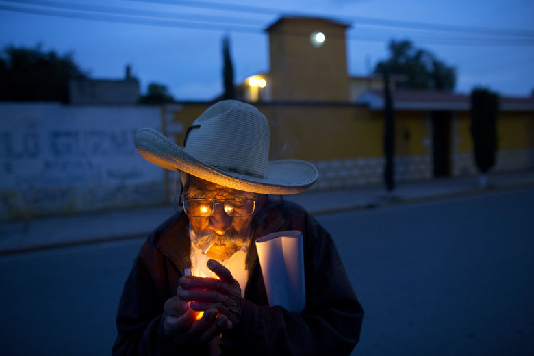 "In this March 31, 2017 photo, farmer Manuel Ortega, 89, lights a cigarette following a strategy meeting by farmers in Tepatepec, Hidalgo state, Mexico. Ortega, who still works in the fields and gets around town by bicycle, said he was raised on the leafy greens, beans and zucchini grown here. ""It never gave me the runs,"" he added with a laugh. (AP Photo/Rebecca Blackwell)"