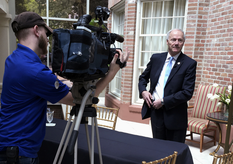Arkansas Gov. Asa Hutchinson prepares for a TV station interview at the Governor's Mansion on Thursday, April 13, 2017, in Little Rock. The governor met with reporters to discuss a series of seven upcoming executions. (AP Photo/Kelly P. Kissel)