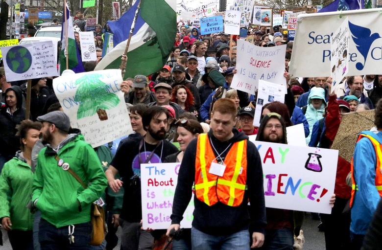 Thousands at Seattle's March for Science head west on Pine Street from Cal Anderson Park to Seattle Center on Saturday.  (Alan Berner / The Seattle Times)