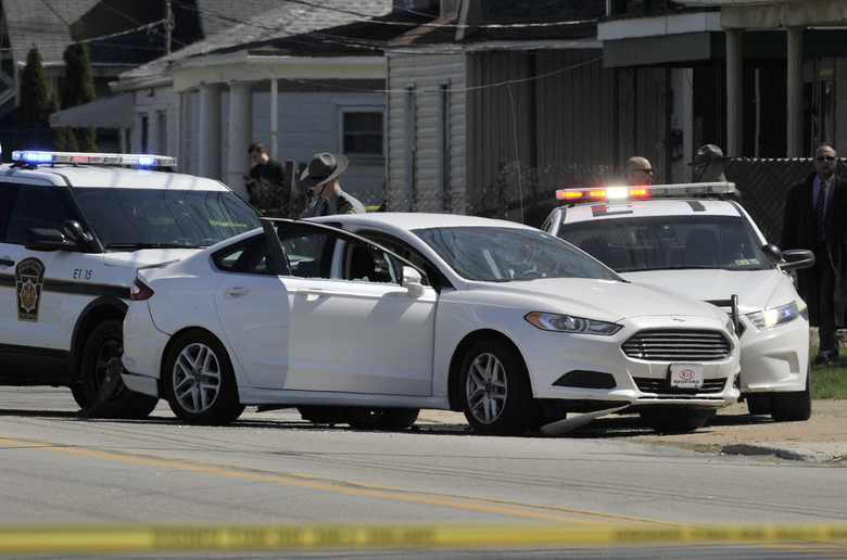 FILE- In this April 18, 2017, file photo, Pennsylvania State Police investigate the scene where Steve Stephens, the suspect in the random killing of a Cleveland retiree posted on Facebook, was found shot dead in Erie. Pa. Cleveland.com reports officers didn't find any electronic devices inside gunman Stephens' car after he led police on a chase in Erie, Pa., and then shot himself dead Tuesday. (Greg Wohlford/Erie Times-News via AP, File)