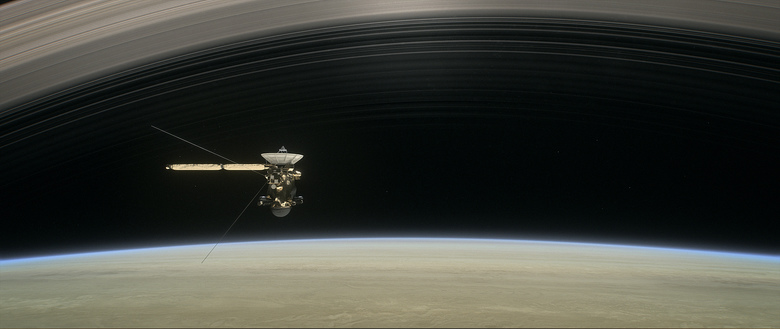 "This image made available by NASA in April 2017 shows a still from the short film ""Cassini's Grand Finale,"" with the spacecraft diving between Saturn and the planet's innermost ring. Launched in 1997, Cassini reached Saturn in 2004 and has been exploring it from orbit ever since. Cassini's fuel tank is almost empty, so NASA has opted for a risky, but science-rich grand finale. (NASA/JPL-Caltech via AP)"