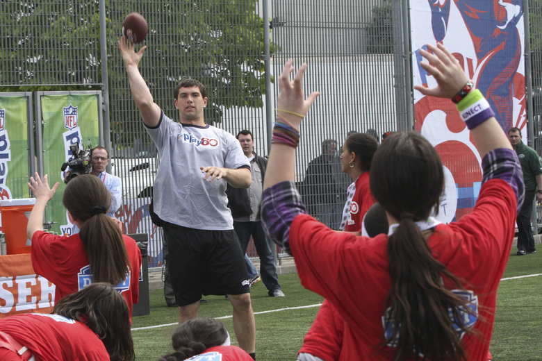 FILE – In this April 25, 2012, file photo, Andrew Luck, center left, throws the ball during the NFL Play 60 Youth Football Festival in New York. When the NFL launched Play 60 a decade ago as a way to get American youth active, the league had no idea what kind of reach the program would have. Ten years later, millions of youngsters and 73,000 schools have become involved, and affiliations with such organizations as the American Heart Association and the National Dairy Council have helpoed make Play 60 one of the nation's most effective anti-obesity and children's activity initiatives in the land.(AP Photo/Mary Altaffer, File)